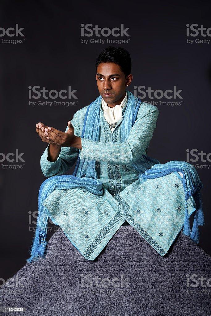 Hindu man sitting in lotus position royalty-free stock photo