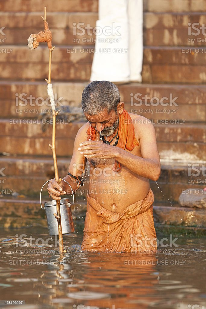 Hindu man taking morning bath in the Ganges river royalty-free stock photo
