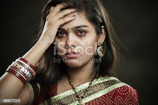 istock Hindu married woman crying with tears and looking at camera. 495672224