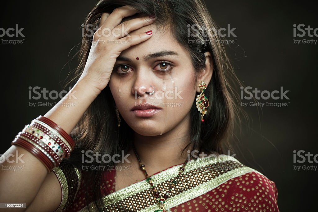 Hindu married woman crying with tears and looking at camera. stock photo