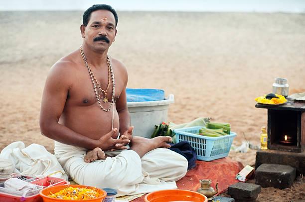 Hindu monk on the beach. stock photo