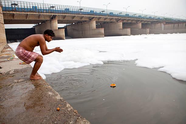 Hindu offering at the Yamuna River, New Delhi stock photo