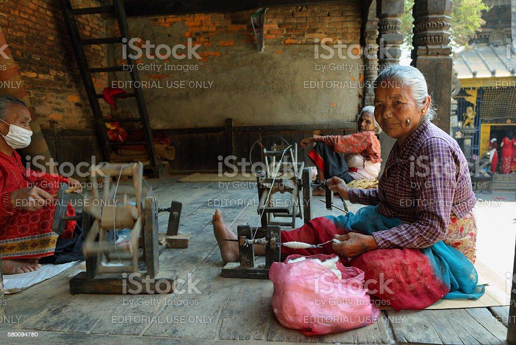 Hindu old woman weaving in Bhaktapur town, Nepal stock photo