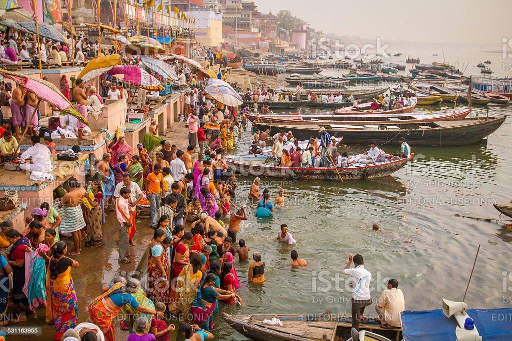 Hindu pilgrims take holy bath in the Ganges river stock photo