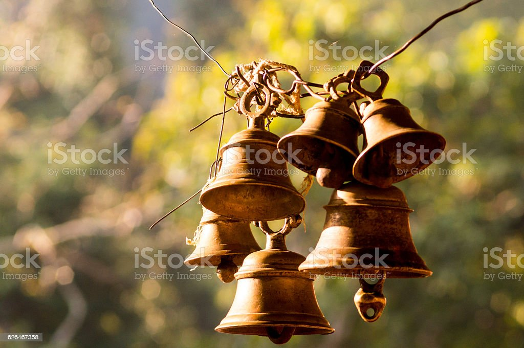 Hindu prayer bells in remote temple in forest stock photo