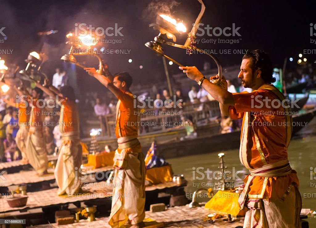 Hindu priest performs the Ganga Aarti religious  ritual - Royalty-free Aarti - Praying Stock Photo