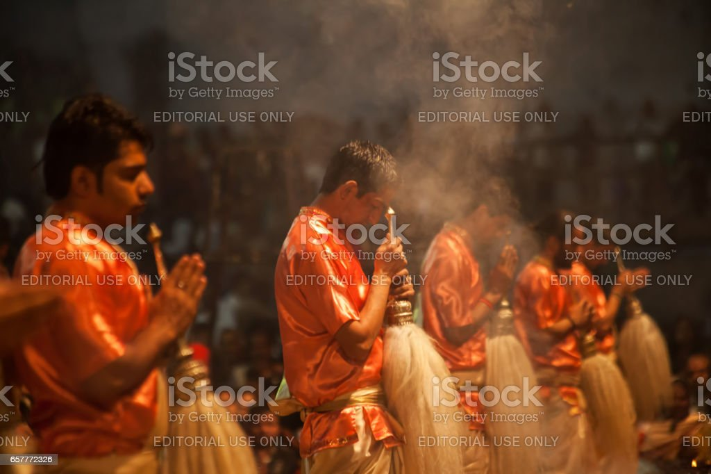 Hindu priests perform an Arti worship ceremony at  Ganges River, stock photo