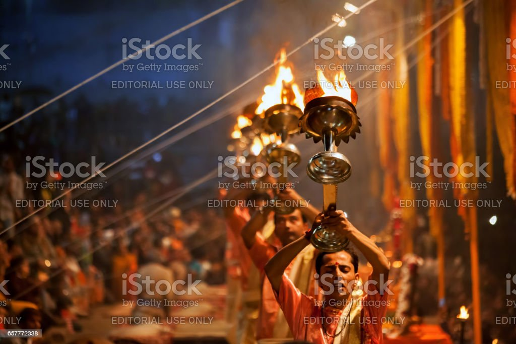 Hindu priests perform an Arti worship ceremony at  Ganges River stock photo