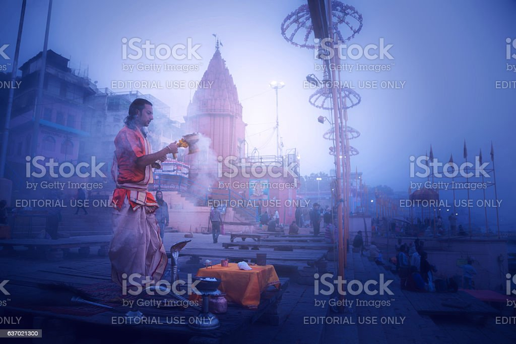 Hindu priests perform an worship, Varanasi. stock photo