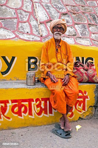 istock Laxman Jhula, India - April 19, 2017: A Hindu sadhu sitting in the streets in Laxman Jhula on the 19th april 2017 in India 689838964