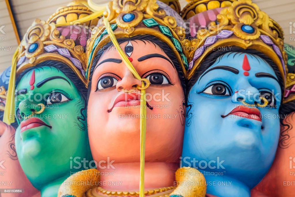 Hindu statue with multiple faces in Sri Lanka stock photo