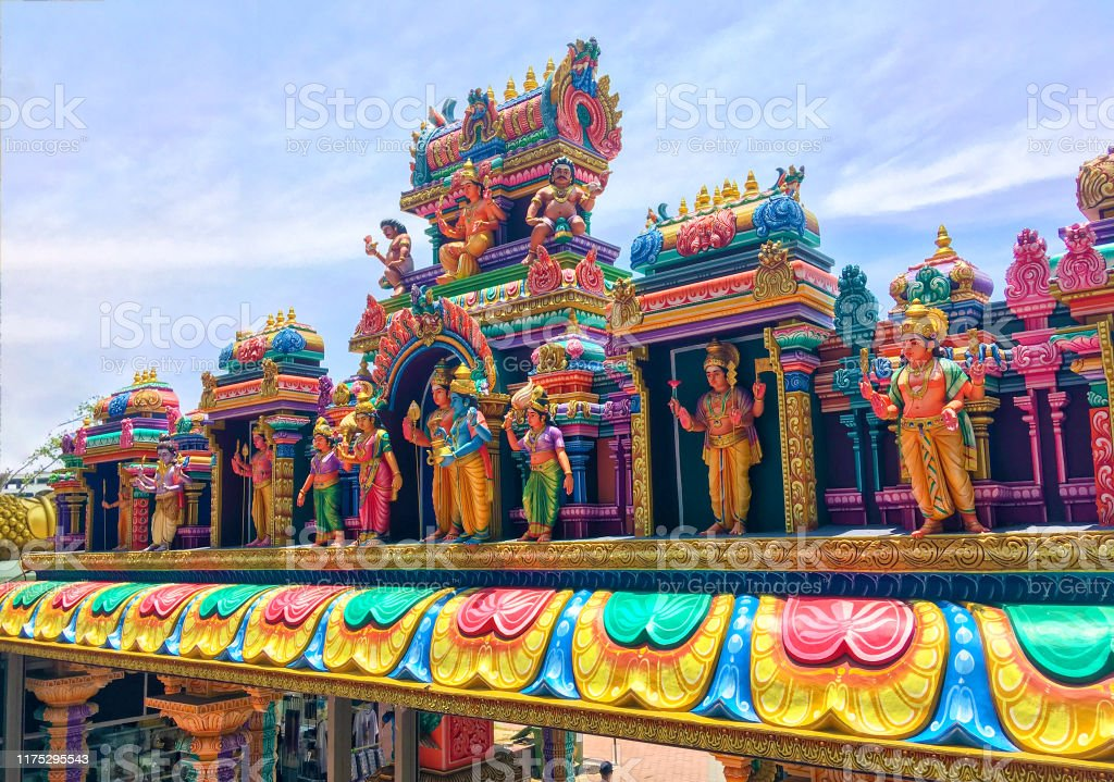 Hindu temple at the Batu Caves in Kuala Lumpur Colorful rainbow statues of hindu gods on roof of Hindu temple located in the bottom of the famous Batu Caves stairs Ancient Stock Photo