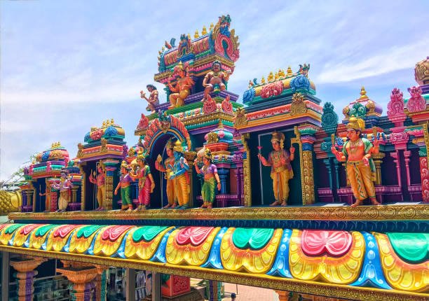 Hindu temple at the Batu Caves in Kuala Lumpur Colorful rainbow statues of hindu gods on roof of Hindu temple located in the bottom of the famous Batu Caves stairs kuala lumpur batu caves stock pictures, royalty-free photos & images