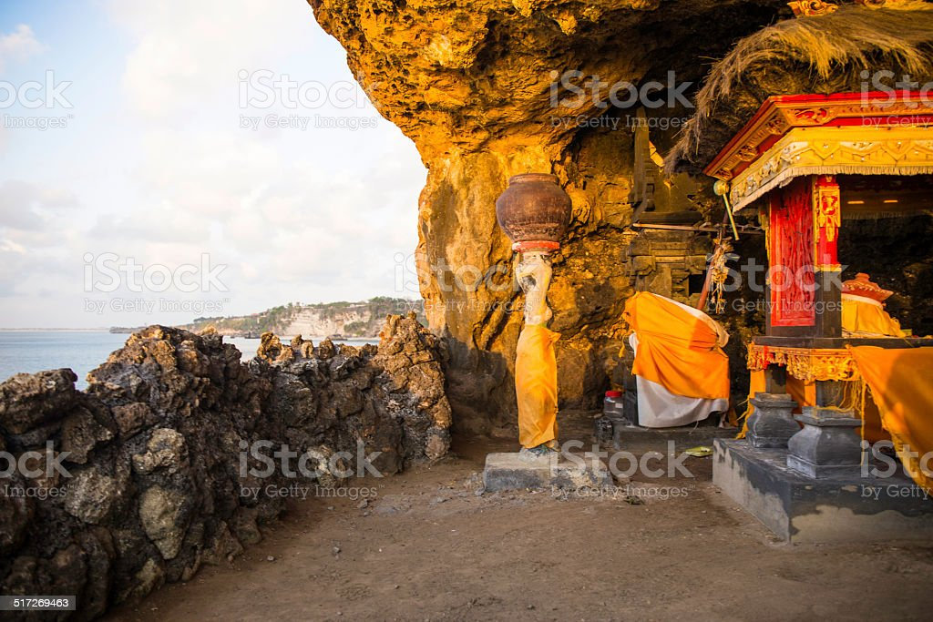 Hindu temple in the cave on the cliff stock photo