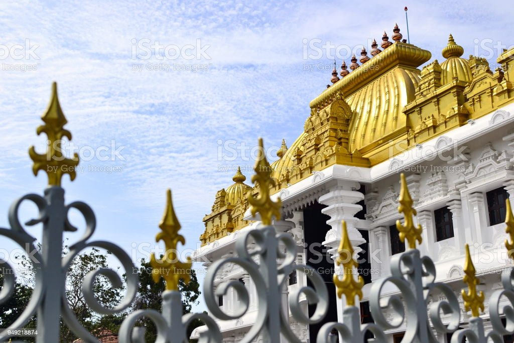 Hindu temple with bright golden roof stock photo