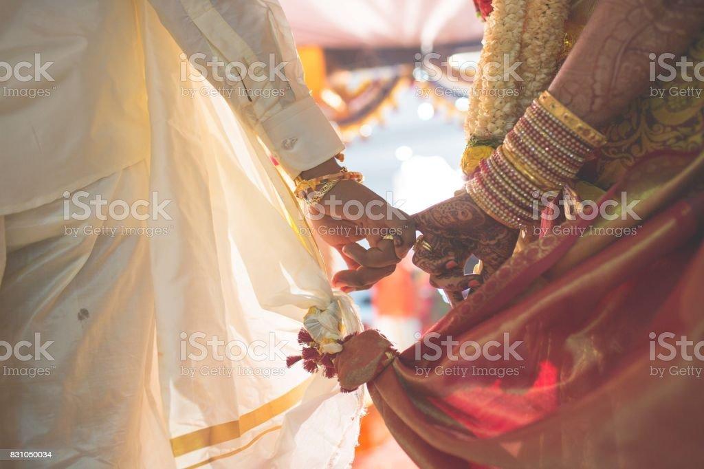hindu wedding hindu wedding bride and groom celebrating wedding event with flower decorations Bridegroom Stock Photo