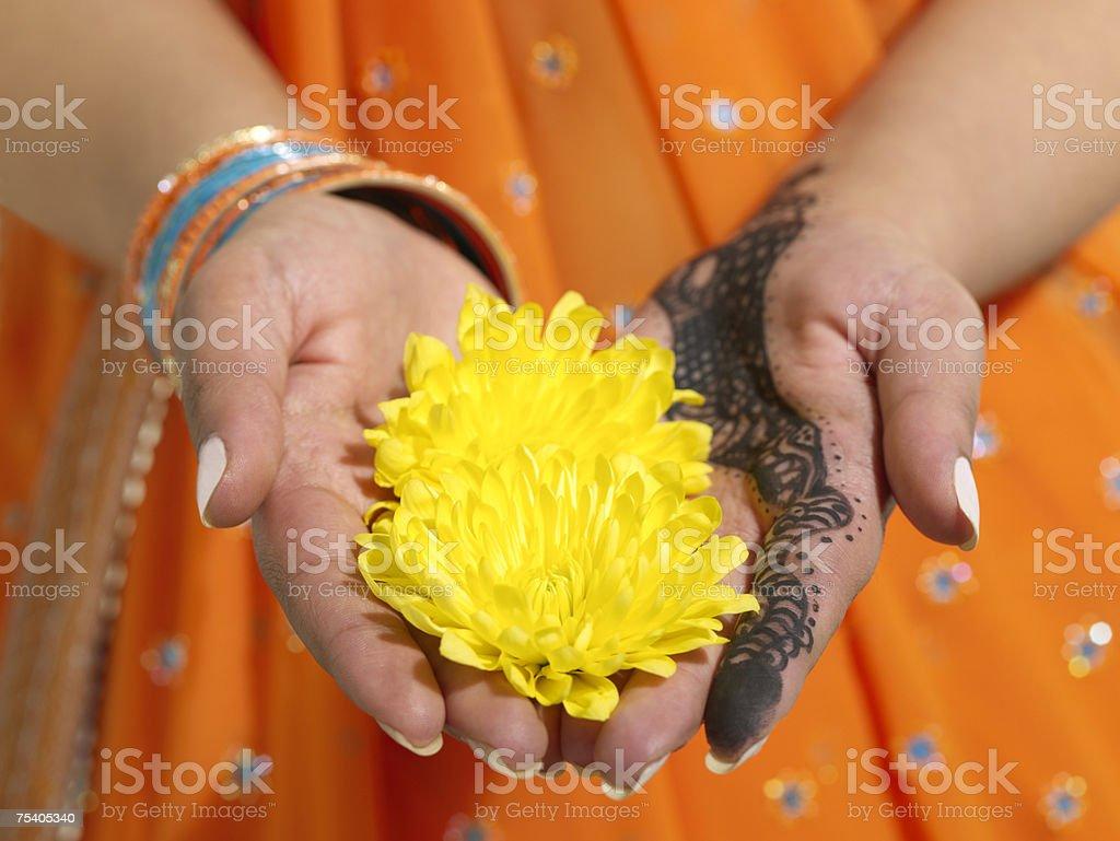 Hindu woman holding a flower foto de stock royalty-free