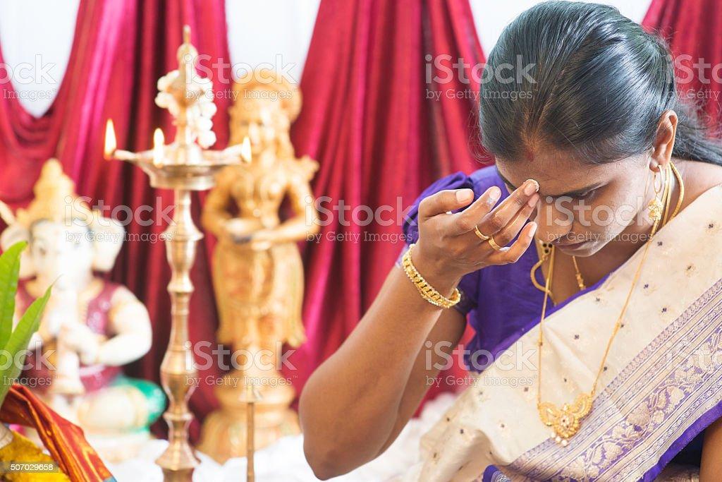 Hindu woman putting bindi stock photo