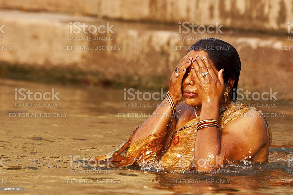 Hindu Woman Taking Morning Bath In The Ganges River Stock