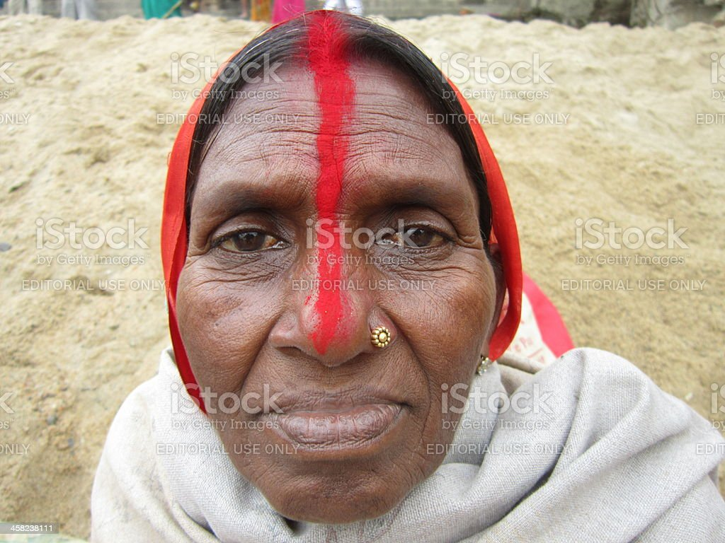 Hindu Woman With Sindur From Hair Through Forehead To Nose Stock