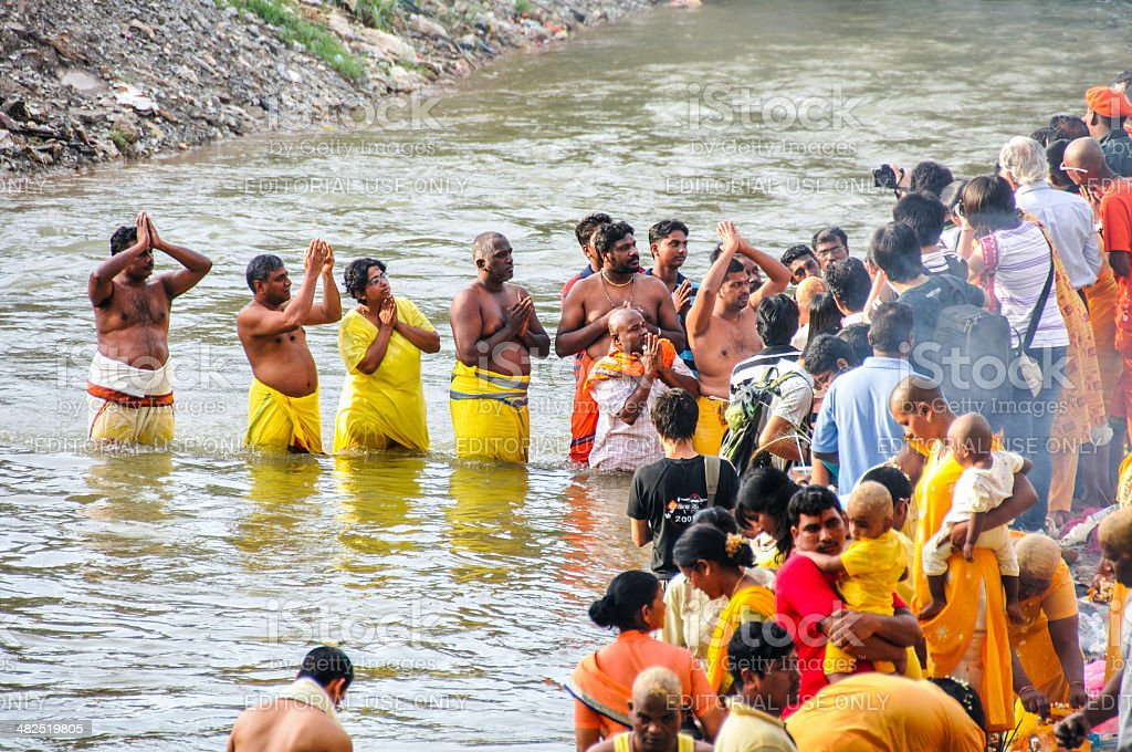 Hindus having bath in the river during Thaipusam stock photo