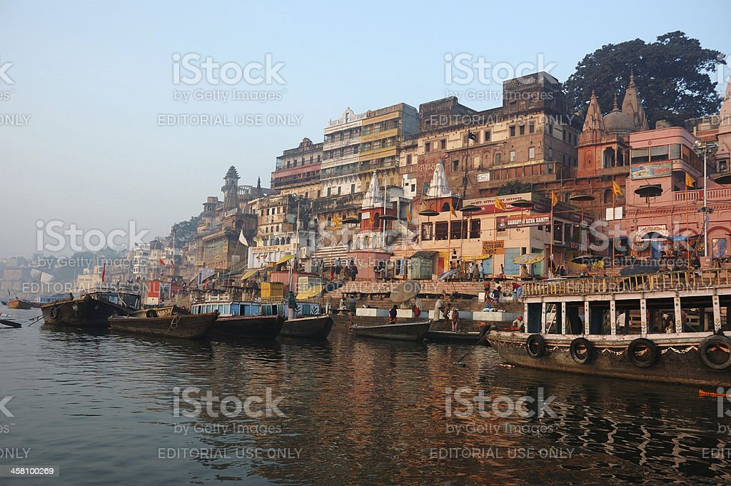 Hindus perform ritual puja at dawn in the Ganges River stock photo