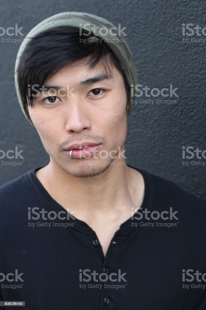 Hip Asian man wearing a beanie stock photo