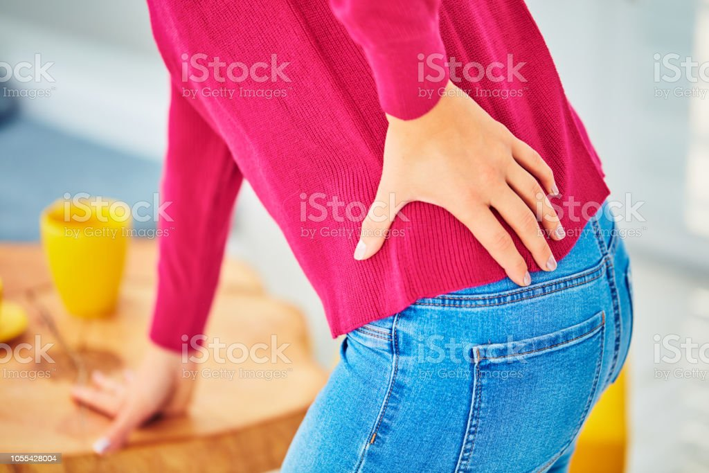 Hip, back and spinal problems in young ages. stock photo