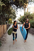 Hip couple in Venice going to surf in the Pacific Ocean
