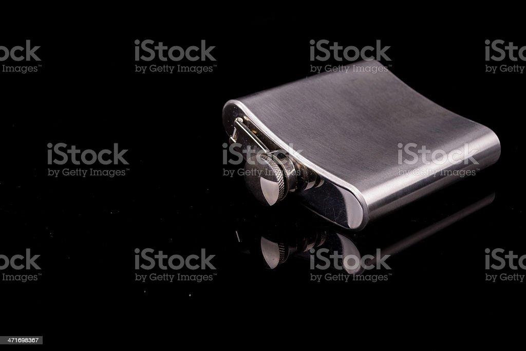 Hip flask on black background. royalty-free stock photo
