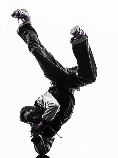 hip hop acrobatic break dancer breakdancing young man handstand stock photo