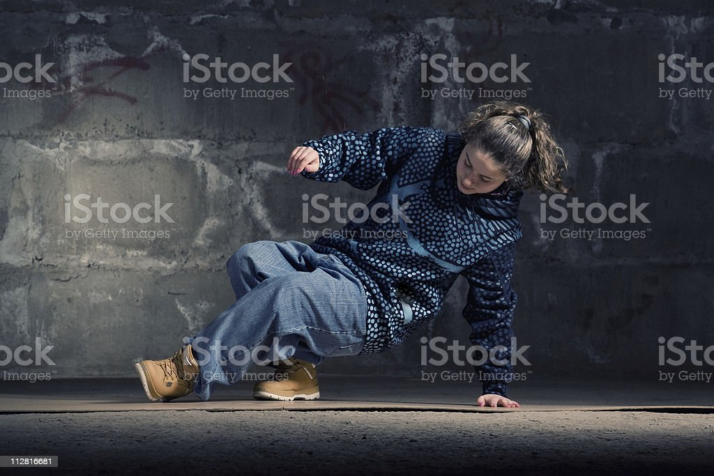 Hip hop dancer in modern style over brick wall stock photo
