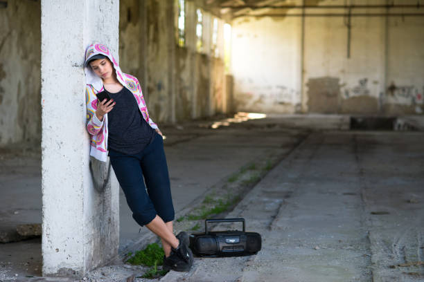 Hip hop female dancer in abandoned building stock photo