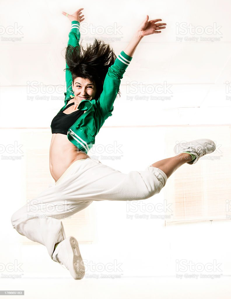 Hip hop girl jumps up royalty-free stock photo