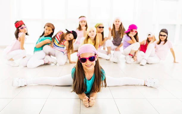 hip hop little dancers. - dance group stock photos and pictures