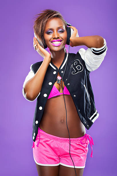 Hip Hop Woman Listening to music stock photo