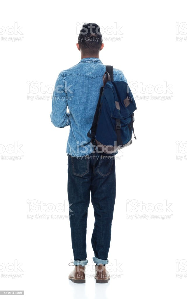 Hip young male student holding books stock photo