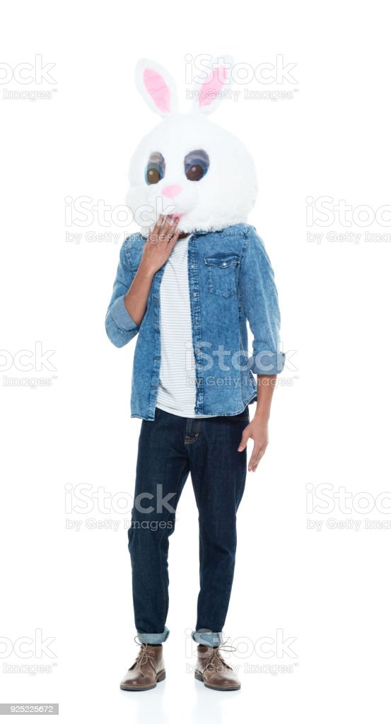 Hip young male wearing a bunny mask stock photo