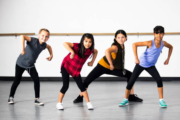 hip-hop dance group of young diverse girls - dance class stock photos and pictures