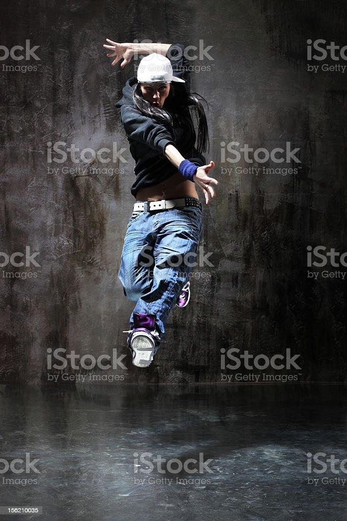 Hip-hop dancer on a black background royalty-free stock photo