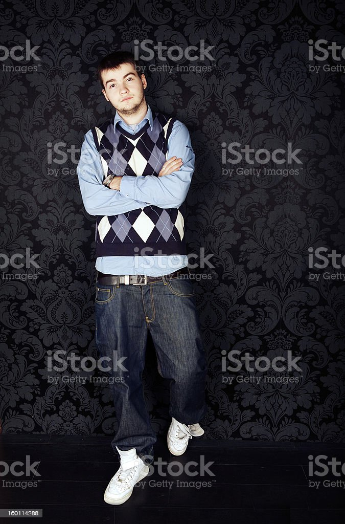 hip-hop style young guy against a black background royalty-free stock photo