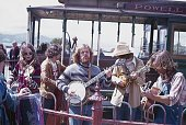 San Francisco, California, USA, 1977. Hippie band plays at a cable car stop in St. Francisco in front of locals and tourists.