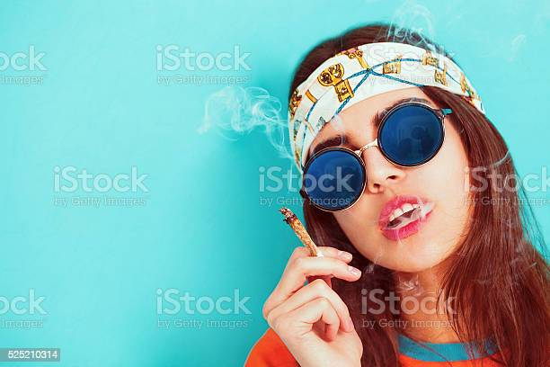 Hippie Girl Portrait Smoking And Wearing Sunglasses Stock Photo - Download Image Now