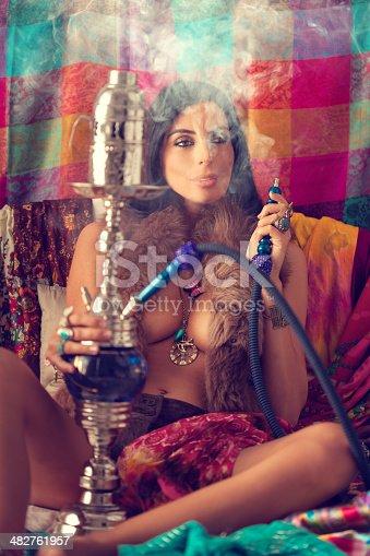 hippie girl smoking water pipe