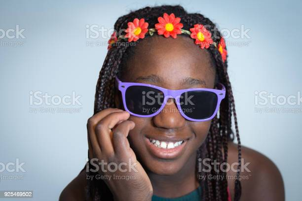 Hippie Girl With Floral Headband And Sunglasses Stock Photo - Download Image Now