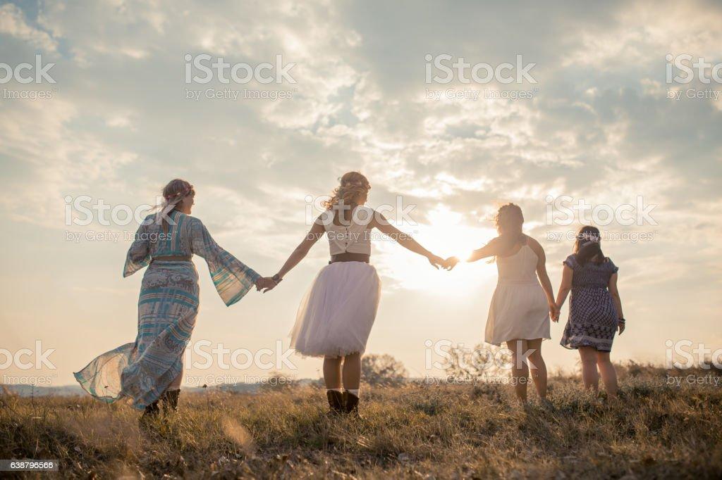 Hippie girls having good fun time outdoors. stock photo
