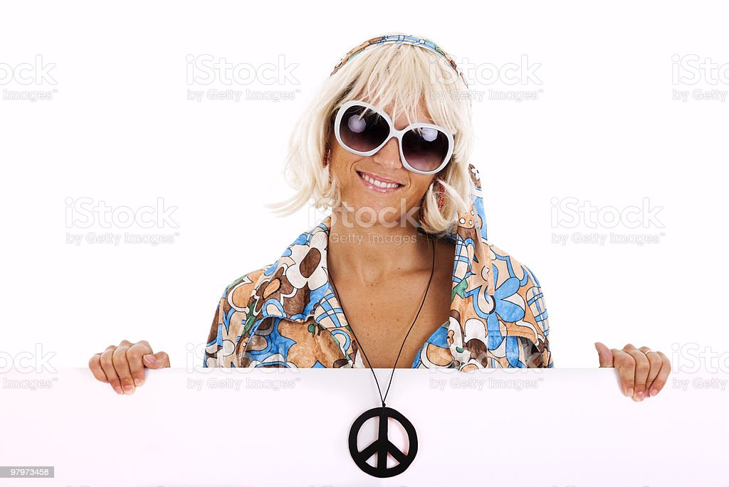 Hippie holding a banner royalty-free stock photo