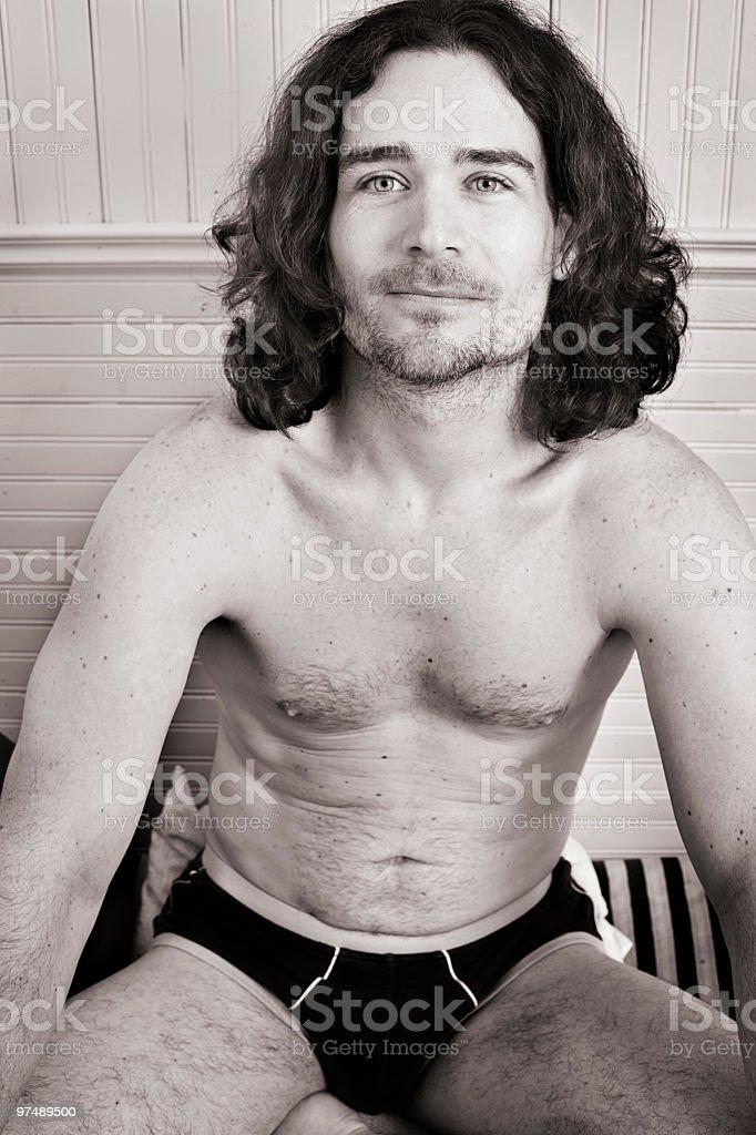 Hippie man sitting in underwear black and white royalty-free stock photo