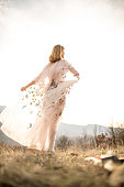 Hippie woman in a floral dress looking at view