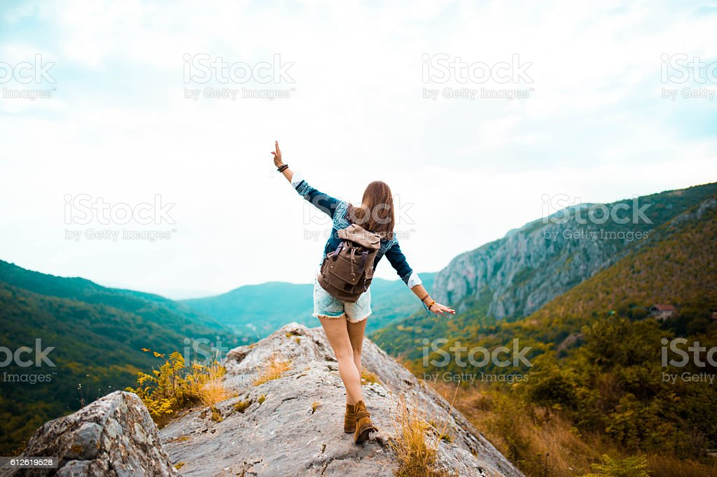 Hippie woman stroll on mountain stock photo